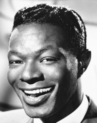 Nat King Cole, Capricorn rising. Notice the perfect Capricorn lobeless ears that connect directly to the head. (Photo: Michael Ochs)
